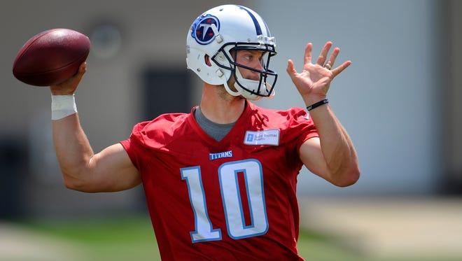Titans quarterback Jake Locker (10) throws a pass during practice at St. Thomas Sports Park Wednesday June 18, 2014, in Nashville, Tenn.