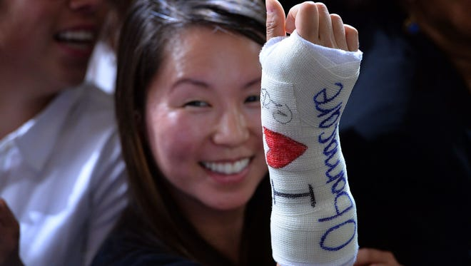Cathey Park after President Obama autographed her cast Wednesday in Boston.