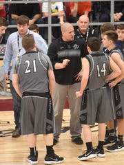 Izard County coach Kyle McCandlis instructs his players