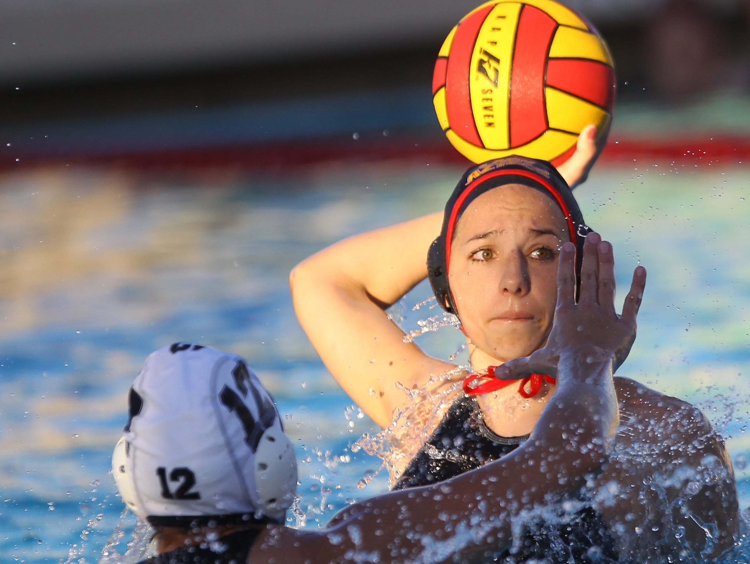 Palm Desert High School's Alyssa Clyde shoots on goal as Xavier Prep's #12 defends during their match at Palm Desert High School.