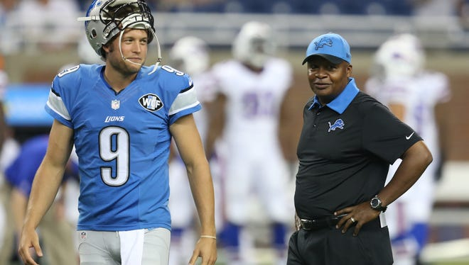 Lions coach Jim Caldwell and QB Matthew Stafford talk before the preseason game against the Bills on Sept. 3, 2015, at Ford Field.