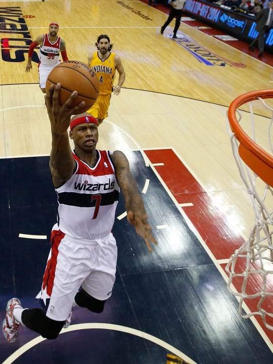 Washington Wizards forward Al Harrington (7) sails toward the basket as Indiana Pacers forward Luis Scola from Argentina (4) looks on during the first half of Game 4 of an Eastern Conference semifinal NBA basketball playoff game in Washington, Sunday, May 11, 2014. (AP Photo/Alex Brandon)