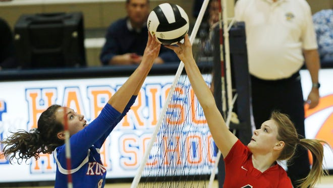 Lafayette Jeff's Piper Stamper has her dink blocked by Kokomo's Kirsten Frey in sectional volleyball action Thursday, October 22, 2015, at Harrison High School. Jeff lost to Kokomo 18-25, 23-25, 15-25.