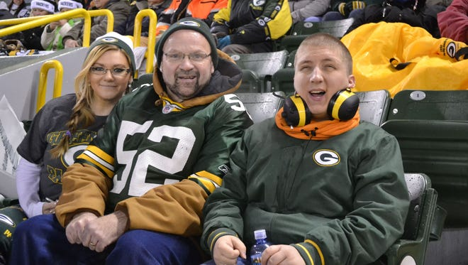 From right, David Jones, Mike Mathews and daughter Tiffany Mathews are in their seats for the start of the Green Bay Packers' game against the Atlanta Falcons on Monday night, Dec. 8, at Lambeau Field. Jones, a Fort Atkinson resident who is legally blind, attended his first Packers game as Mike and Tiffany Mathews chaperoned a trip that started in Tulsa, Okla., where Jones is a student at Oral Roberts University.