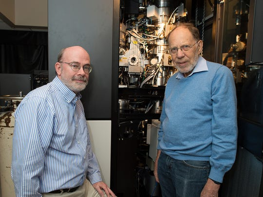 File photo. Richard Kuhn, left, and Michael Rossmann stand with the cryo-electron microscope used to determine the structure of the Zika virus.