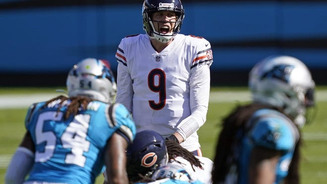 Chicago Bears quarterback Nick Foles (9) calls a play during the second half against the Carolina Panthers in Charlotte, N.C., Sunday, Oct. 18, 2020.