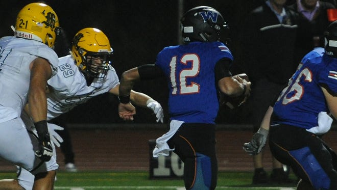 Westlake quarterback Jake Kaplinski breaks away from the Moorpark defense during the Warriors' 24-21 win last Friday night. Unbeaten Westlake (5-0) gets another big test when it plays at 4-1 Oxnard this Friday night.