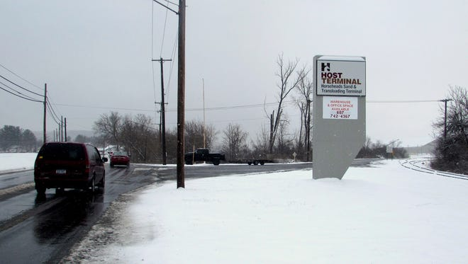 Traffic passes by the North Main Street entrance to the HOST business park in Horseheads.