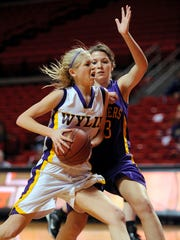 Wylie's Petyon Little (23) drives to the basket past