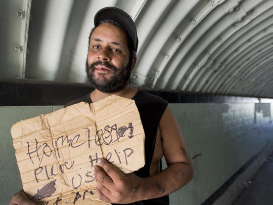 A homeless Salisbury man displays a sign asking for