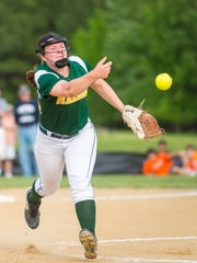 Mardela pitcher Kalie Adkins (14) throws to first after fielding a grounder against Saint Michael's in the 1A East Region Finals at Saint Michael's High School on Friday, May 20.