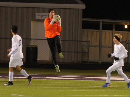 Wylie keeper Cameron Dawsey jumps to control the ball during the 2-0 win against Amarillo Tascosa on Friday, Feb. 2, 2018 at Bulldog Stadium.