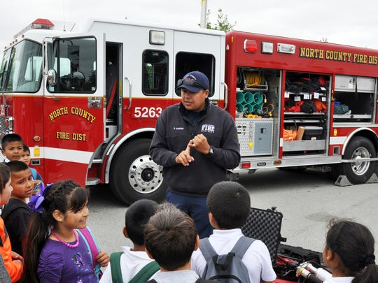 North County Firefighter Randy Sanchez, explains some