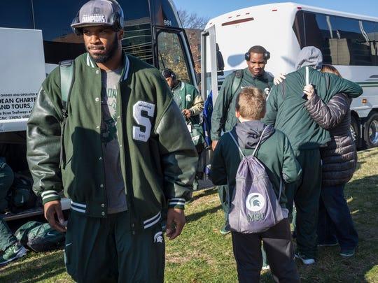 The MSU football team returns to campus after winning the Big Ten championship Sunday, December 6, 2015.
