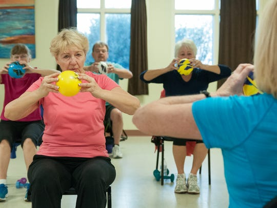 Tama Garski, 72, left, works out with others during a Wellness Workout at MountainView Senior Circle.