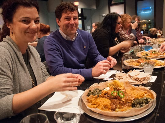 This Advertiser file photo shows Melissa and Stephen Gaubert of Lafayette dining at an Ethiopian dinner at the Jefferson Street Pub. World Kitchen Pop-Up is putting on a benefit event that will allow diners to taste the world for a good cause.