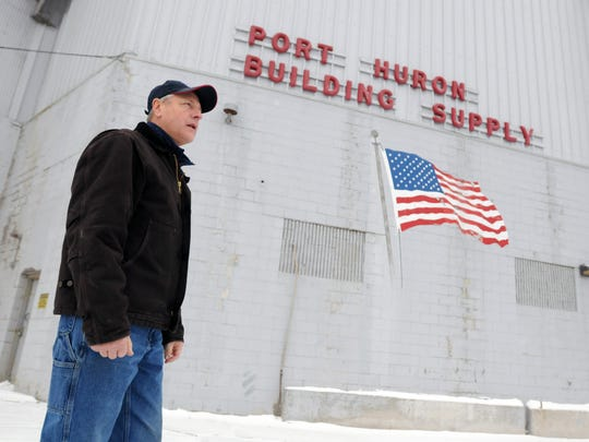 President of Port Huron Building Supply Michael Lauth walks around the cement manufacturing building Monday, Feb. 15, at Port Huron Building Supply in Port Huron.