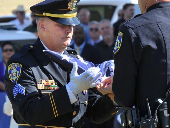 Wichita Falls police detective Bill Henning receives