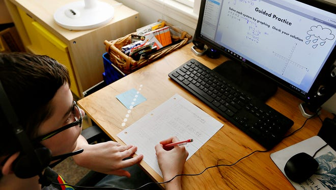 Ethan Moore, 14, who has been diagnosed with Asperger syndrome, follows along in his Pennsylvania Cyber Charter School algebra class at his home in Wrightsville, Wednesday, April 6, 2016. Moore has done well in his cyber classes since being pulled from public school because the standardized testing was overwhelming for him. Dawn J. Sagert photo