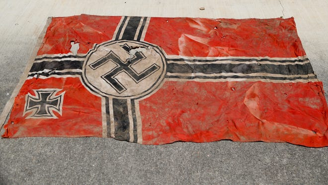 This Nazi flag was found Monday during the cleanup for the vandalized sculptures of of interstate 5.