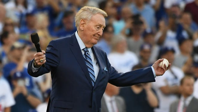 Vin Scully brought down the house at Dodger Stadium by not throwing out the first pitch before Game 2 of the World Series.