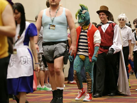 Gen Con attendees parade through the Indiana Convention