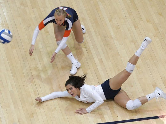 UTEP's Danie Orozco, bottom, digs a shot as teammate