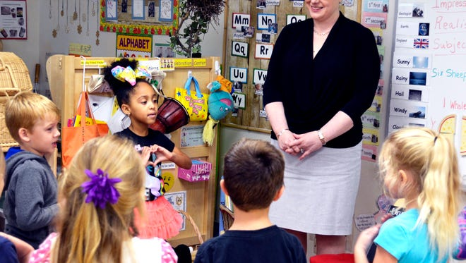 Florida State Representative Erin Grall talks with Childcare Resources students during the Week of the Young Child.