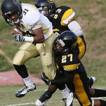 Arkansas-Pine Bluff's Andre Mitchell (31) gets tackled by GSU's offensive guard Troy Roach (53) and Tyree Hollins (27) during the game's first half on Saturday, Nov. 10, 2012.
