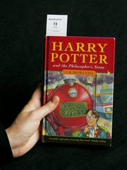 """A first-edition copy of J.K. Rowling's first novel """"Harry Potter and the Philosopher's Stone"""" is displayed at offices of the Bonhams auction house in London on June 6, 2007."""
