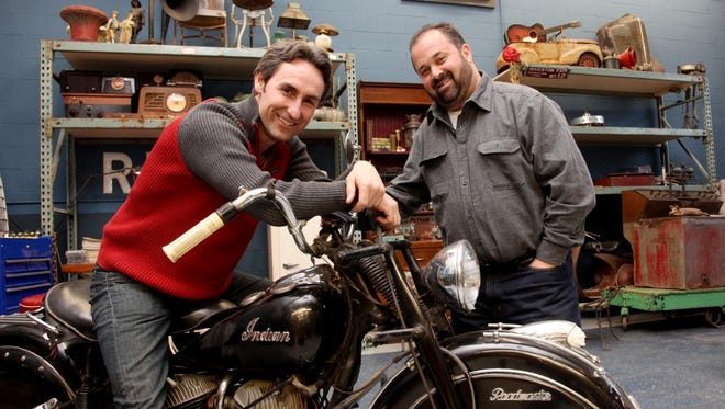 """Mike Wolfe, left, and Frank Fritz star in the History Channel's """"American Pickers"""" and run a store called Antique Archeology in LeClaire, Iowa."""
