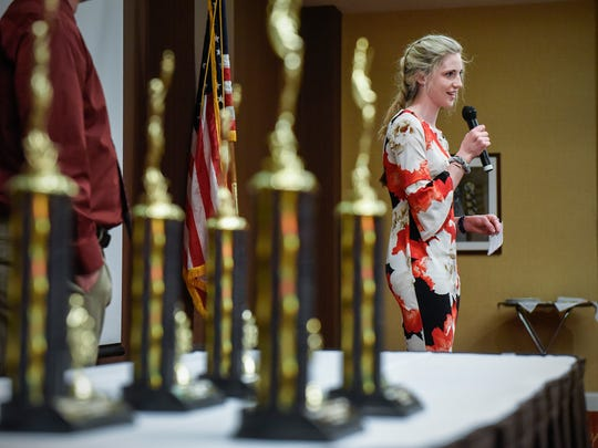 Kate Tomczik, St. Cloud Cathedral, accepts her award during the Annual St. Cloud Exchange Club Honor Athlete Luncheon  Wednesday, May 9, at the Courtyard by Marriott.