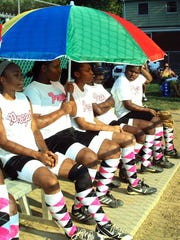 The Paterson Preps softball team shows off its trademark argyle socks during a summer tournament.