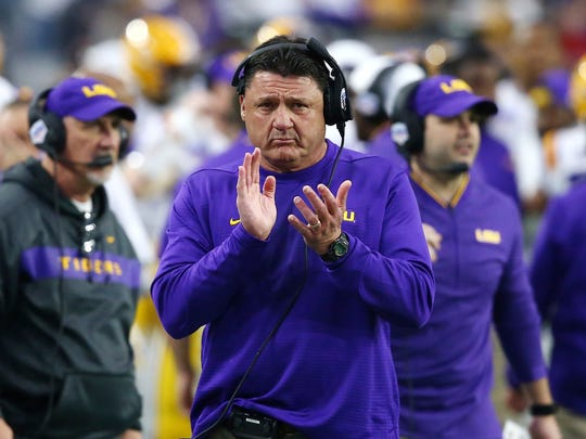 LSU head coach Ed Orgeron applauds his players during