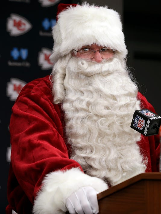 Kansas City Chiefs head coach Andy Reid wears a Santa Claus costume during a news conference following an NFL football game against the Miami Dolphins in Kansas City, Mo., Sunday, Dec. 24, 2017. (AP Photo/Orlin Wagner)