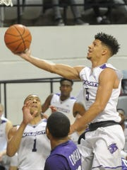 ACU's Payten Ricks drives to the basket against the