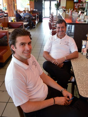 Manager Matt Tyranski and his father-in-law Bill Skotanis have kept Olympic Coney Island in Westland open through all of the construction.