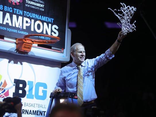 Michigan head coach John Beilein celebrates winning