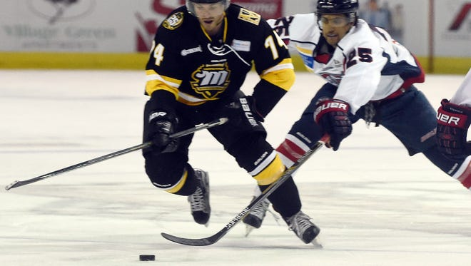 Matt Harrington of the Mississippi Riverkings and Tommy Fiorentino of the Evansville Thunderbolts race for the during the first period of the game at the Ford Center in Evansville Saturday.