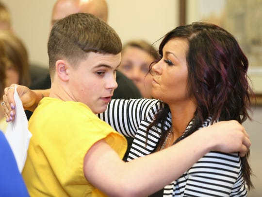 Kristi Blevins hugs her son after his sentencing for the shooting at Madison High School last year.