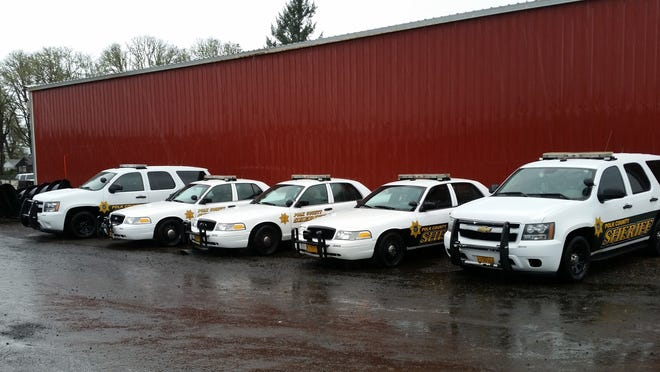 These patrol vehicles sit unused because the Polk County Sheriff's Office doesn't have the deputies to drive them.