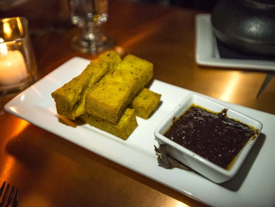Roasted garlic and herb polenta fries with whiskey-bacon