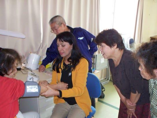 Dr. Mona Khanna teaches survivors of the 2011 Japan