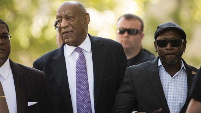 Bill Cosby arrives with Ccmedian Joe Torry Day 5 of his sexual assault trial in Norristown, Pa., on June 9, 2017.