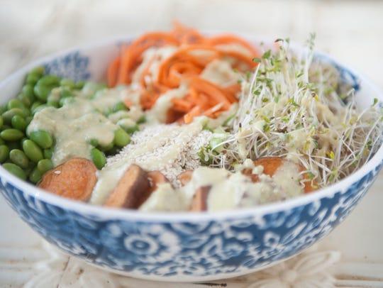 Miso quinoa bowl with carrots, sprouts, edamame, hemp