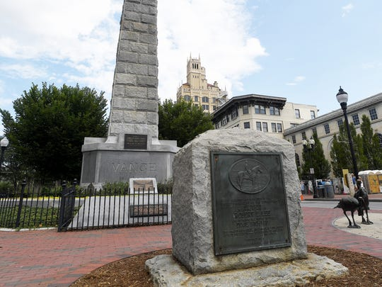 A memorial for Robert E. Lee in front of Vance Monument in Pack Square August 16, 2017.