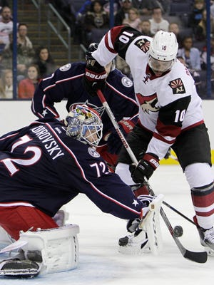 Columbus Blue Jackets' Sergei Bobrovsky, left, of Russia, makes a save against Arizona Coyotes' Anthony Duclair during the first period of an NHL hockey game, Saturday, Nov. 14, 2015, in Columbus, Ohio.