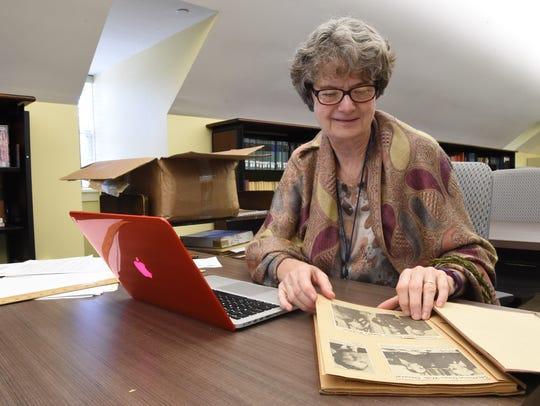 Library volunteer, Linda Bouchey, a retired teacher