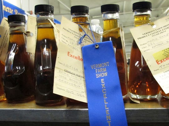 In this Monday, Jan. 29, 2018 photo, maple syrup entries rated as excellent sit on a table at the Vermont Farm Show in Essex Junction, Vt. Each year a panel of judges rates the entries in the state that is the largest producer of maple syrup.
