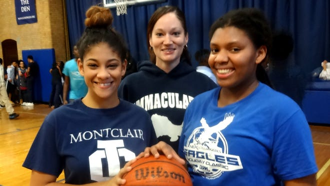 Immaculate Conception's Angela Mangual (left) and Imani Burroughs (right) with coach Anne Lauterhahn.